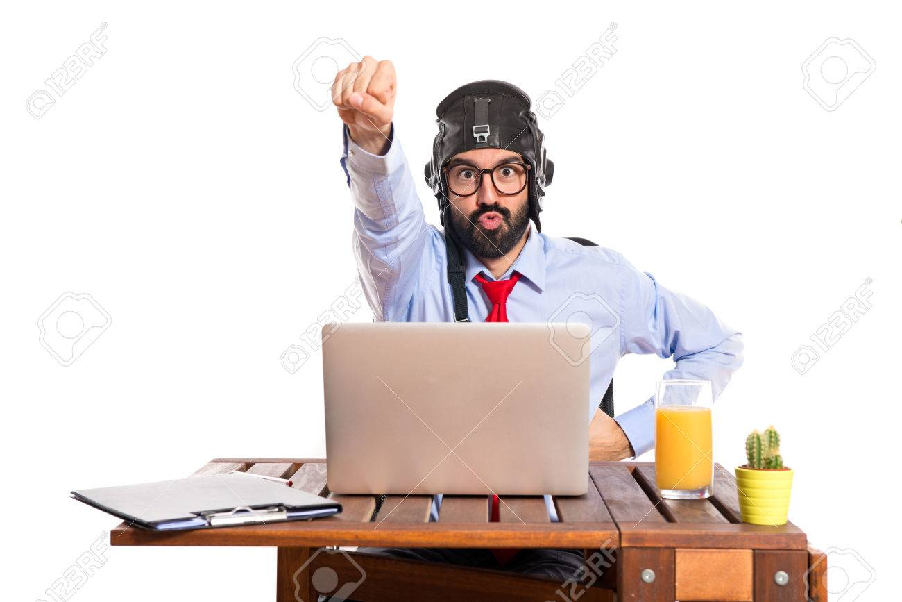 Businessman in his office with pilot hat Stock Photo - 34848266