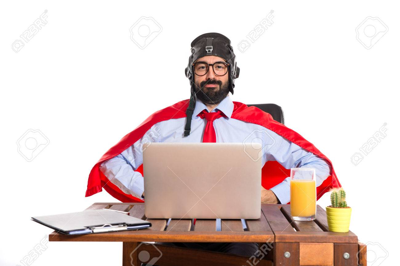 Businessman in his office with pilot hat Stock Photo - 34848267