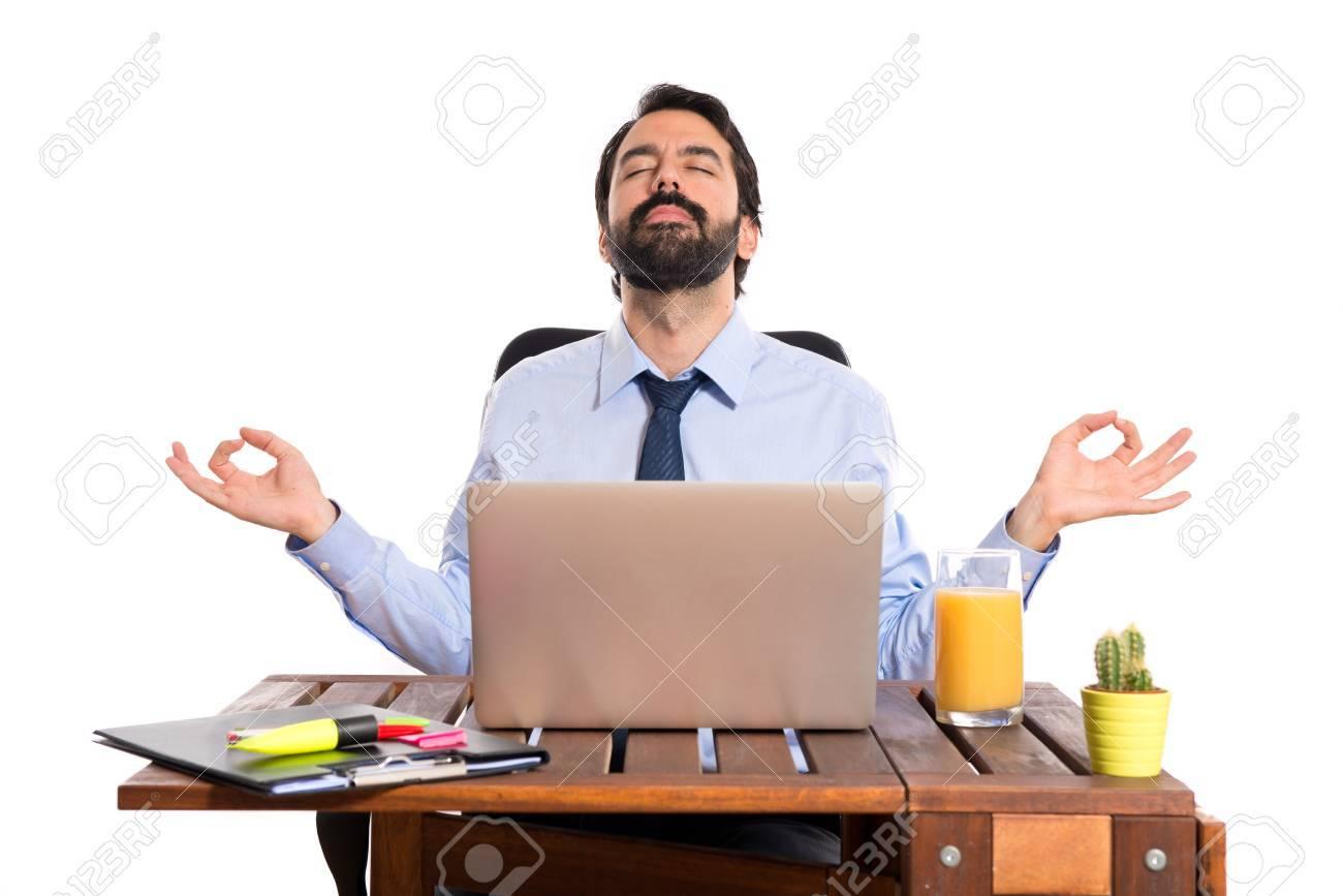 Businessman in his office in zen position - 33527628