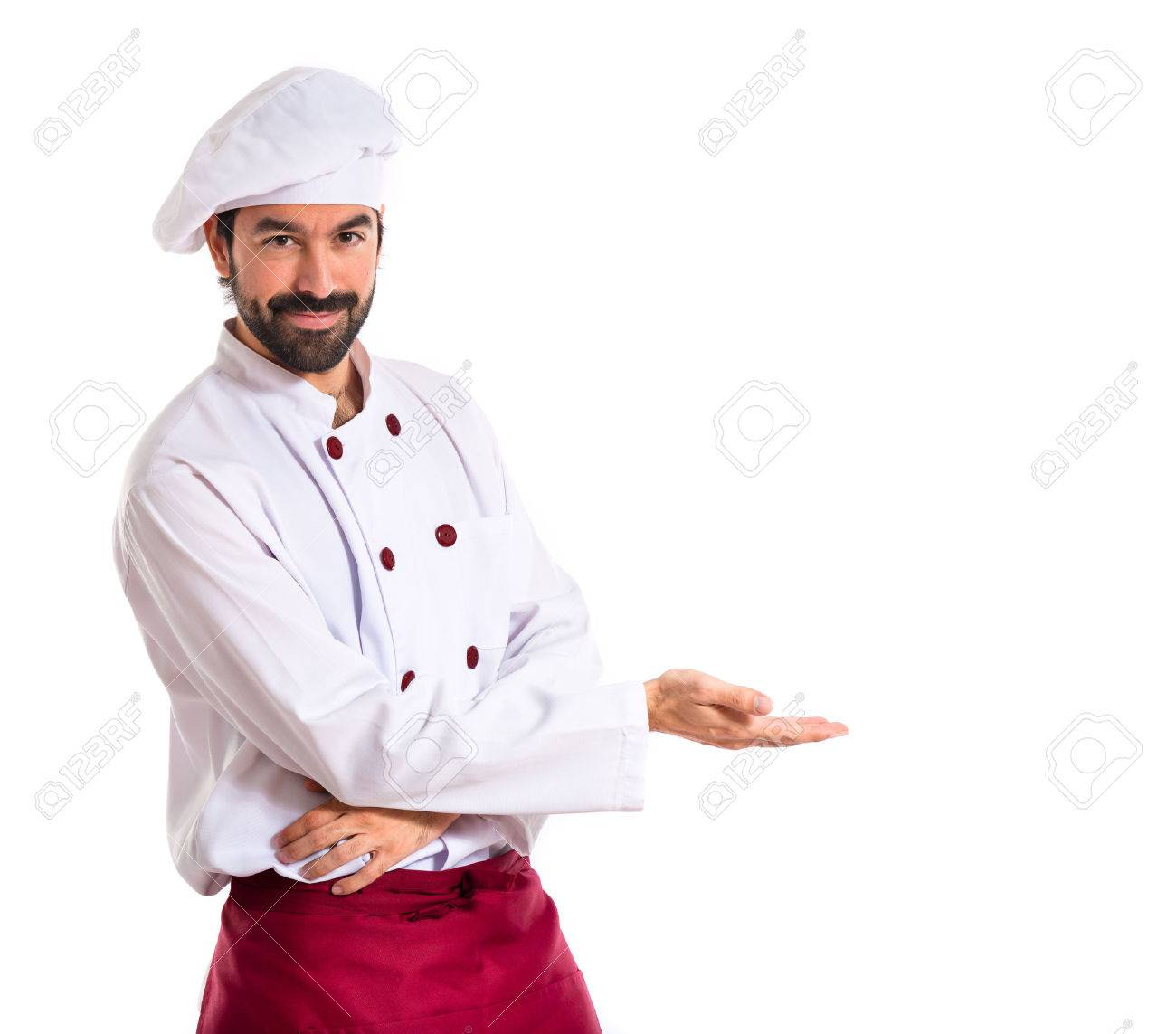 Chef presenting something over white background - 34710150