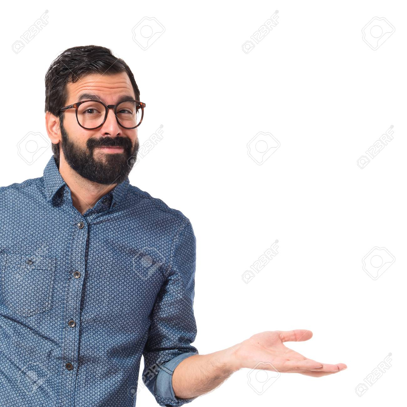 Young hipster man having doubts over white background - 34535039