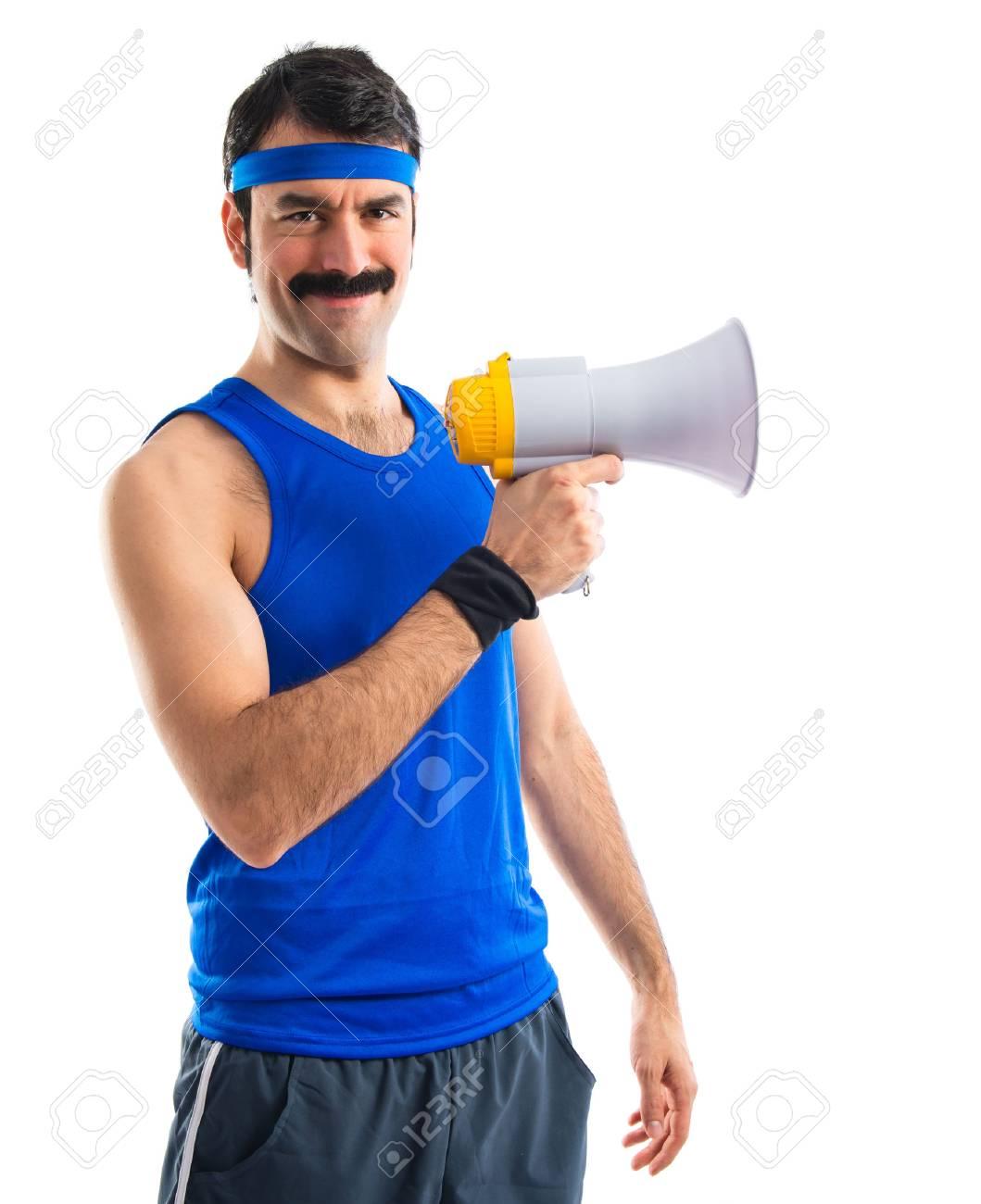 Sportman shouting by megaphone - 36559841