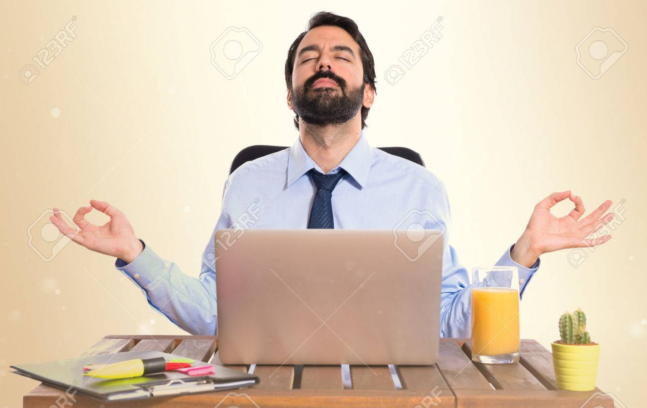 Businessman in his office in zen position - 37676019