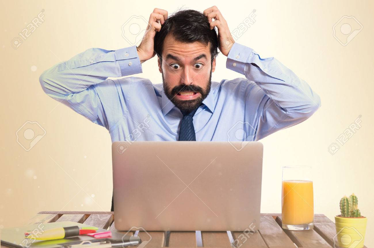 frustrated businessman over white background - 37676021