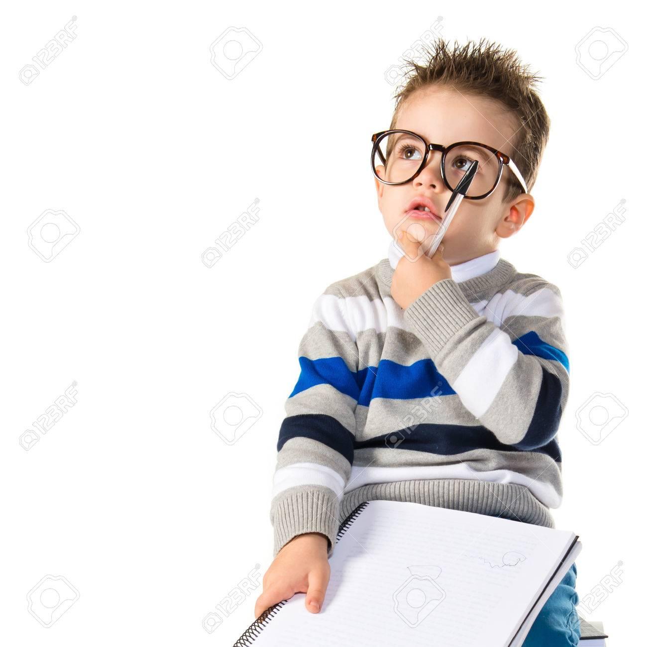 Kid thinking on books Stock Photo - 37614142