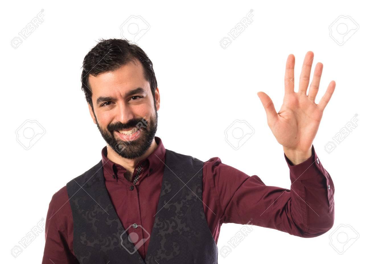 Man wearing waistcoat saluting - 39156966
