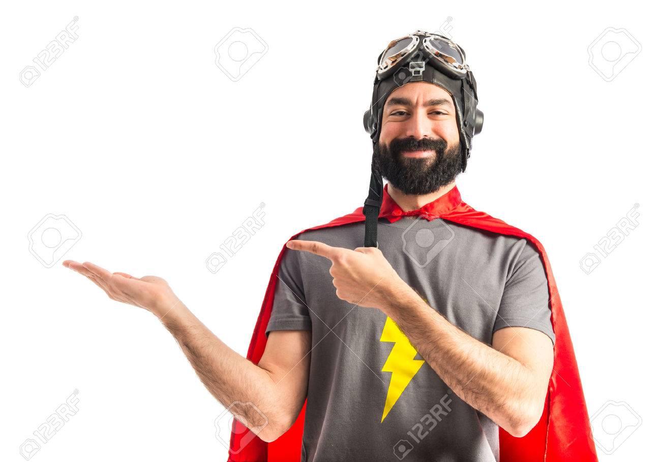 Superhero holding something Stock Photo - 40412316