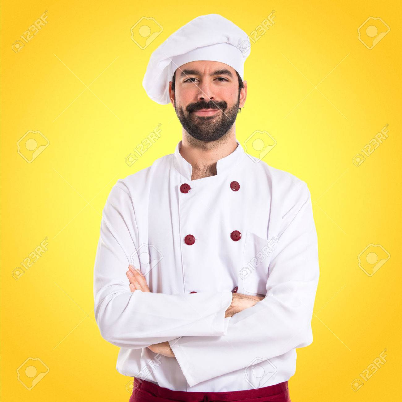 Chef with his arms crossed over white background - 40989323