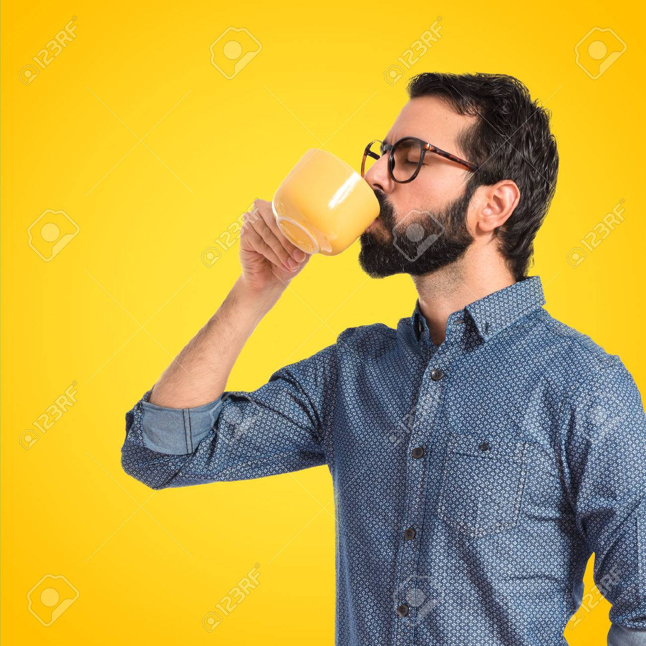 Young hipster man drinking coffee over white background - 40989425