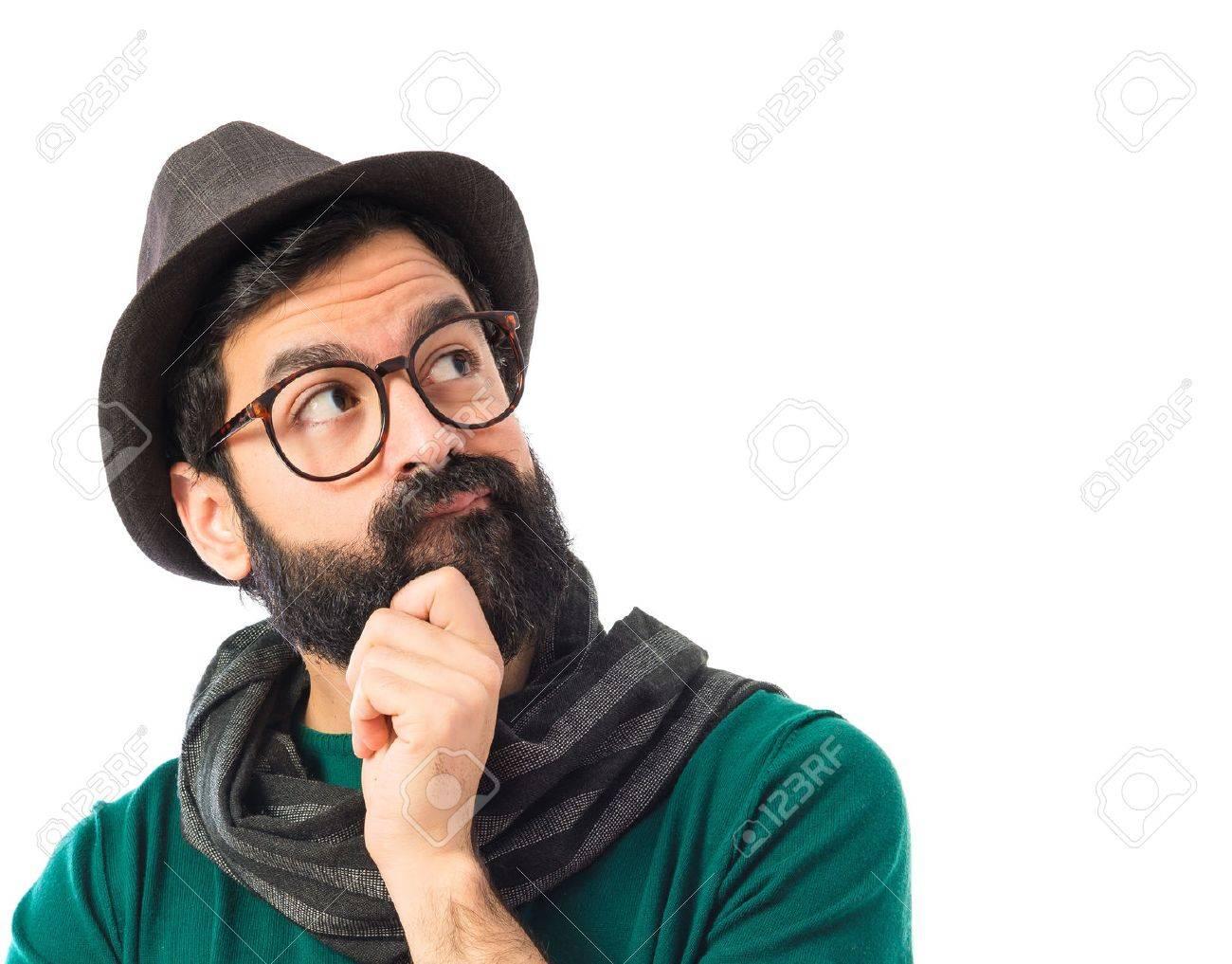 Bohemian man thinking over white background - 41585432
