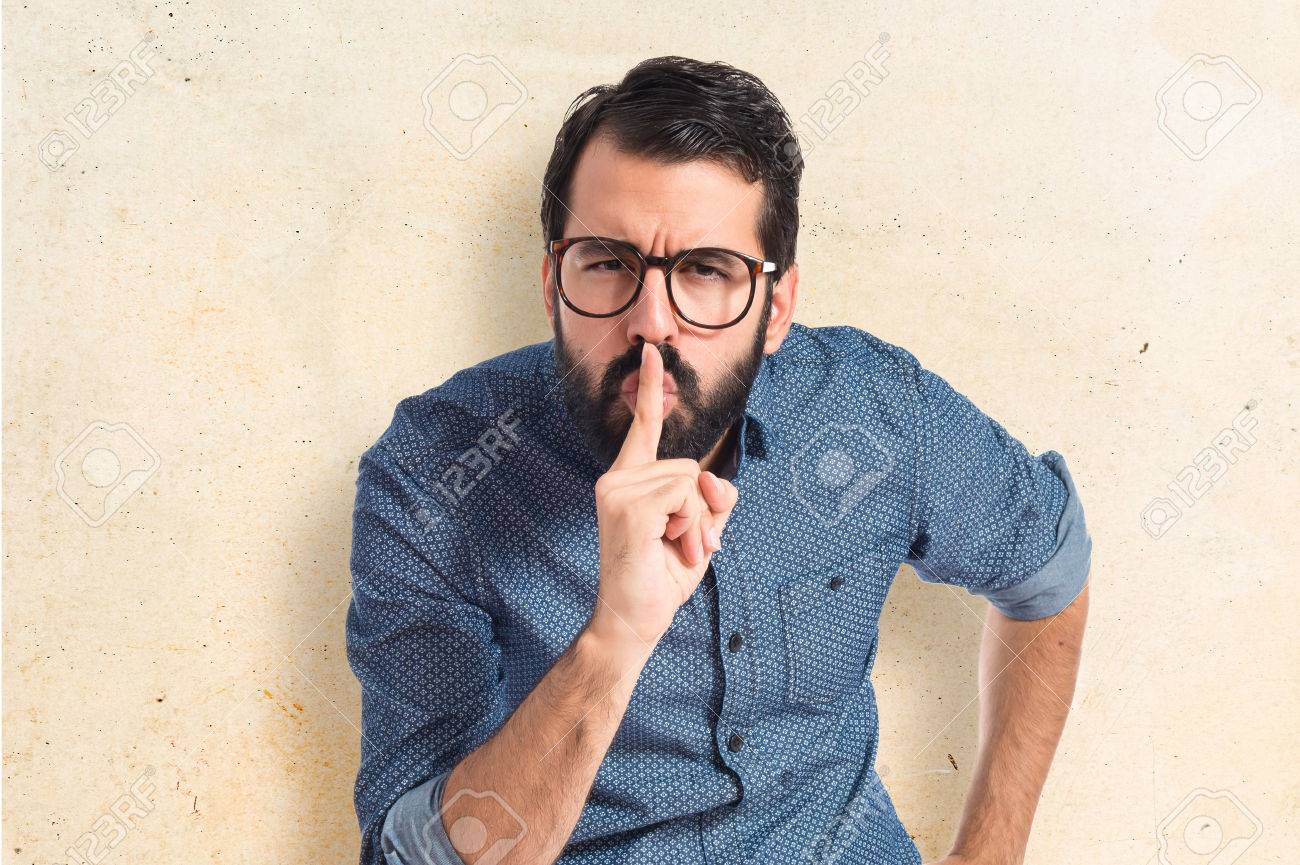 Young hipster man making silence gesture Stock Photo - 41586010