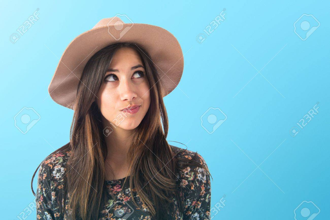 Cute woman thinking Stock Photo - 43293872