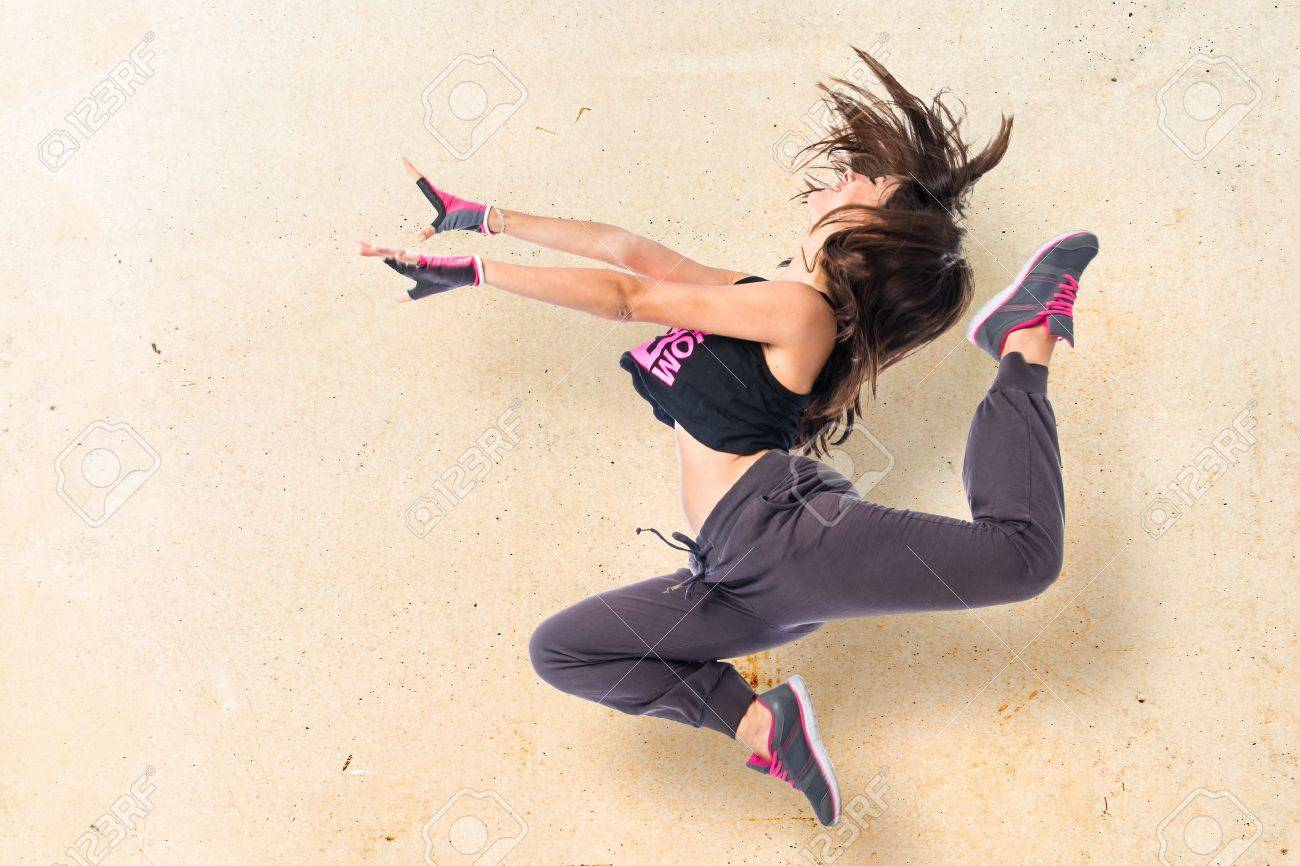 Teenager girl jumping in hip hop style Stock Photo - 43944751