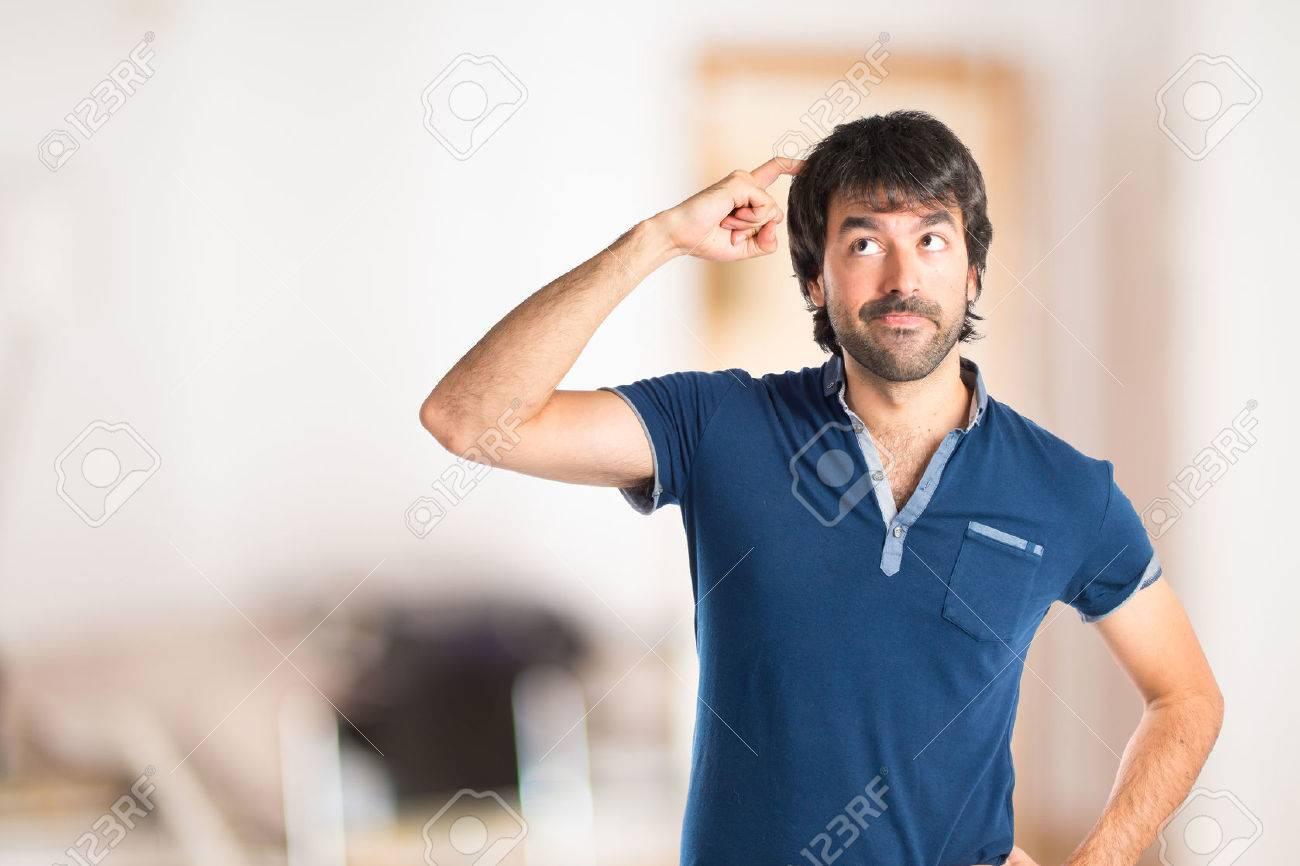 Man thinking over isolated white background - 43935902