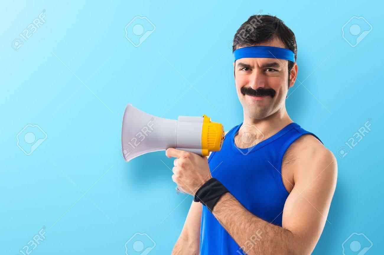 Sportman shouting by megaphone Stock Photo - 45092755
