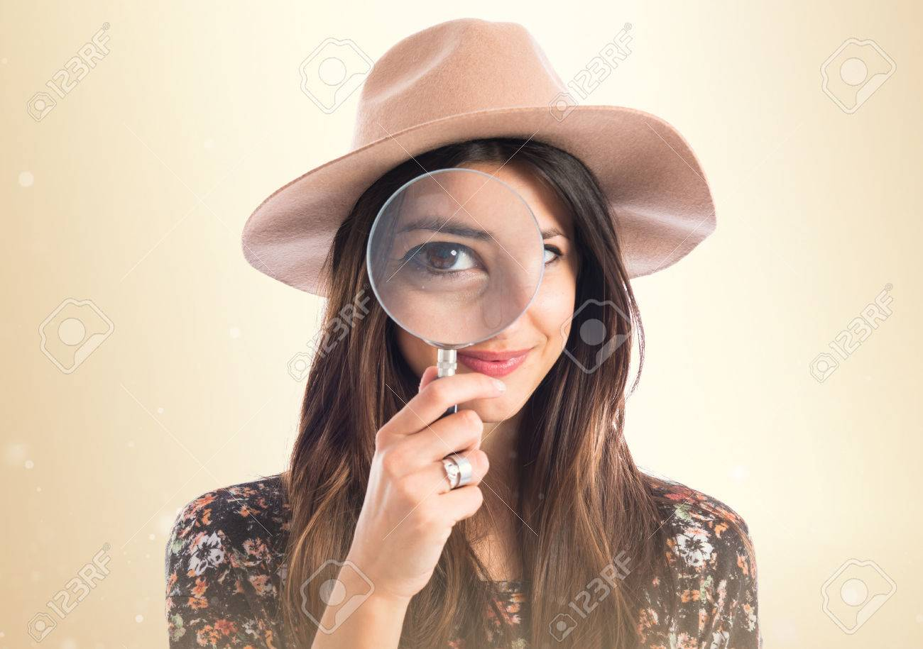 Woman with magnifying glass Stock Photo - 45219448