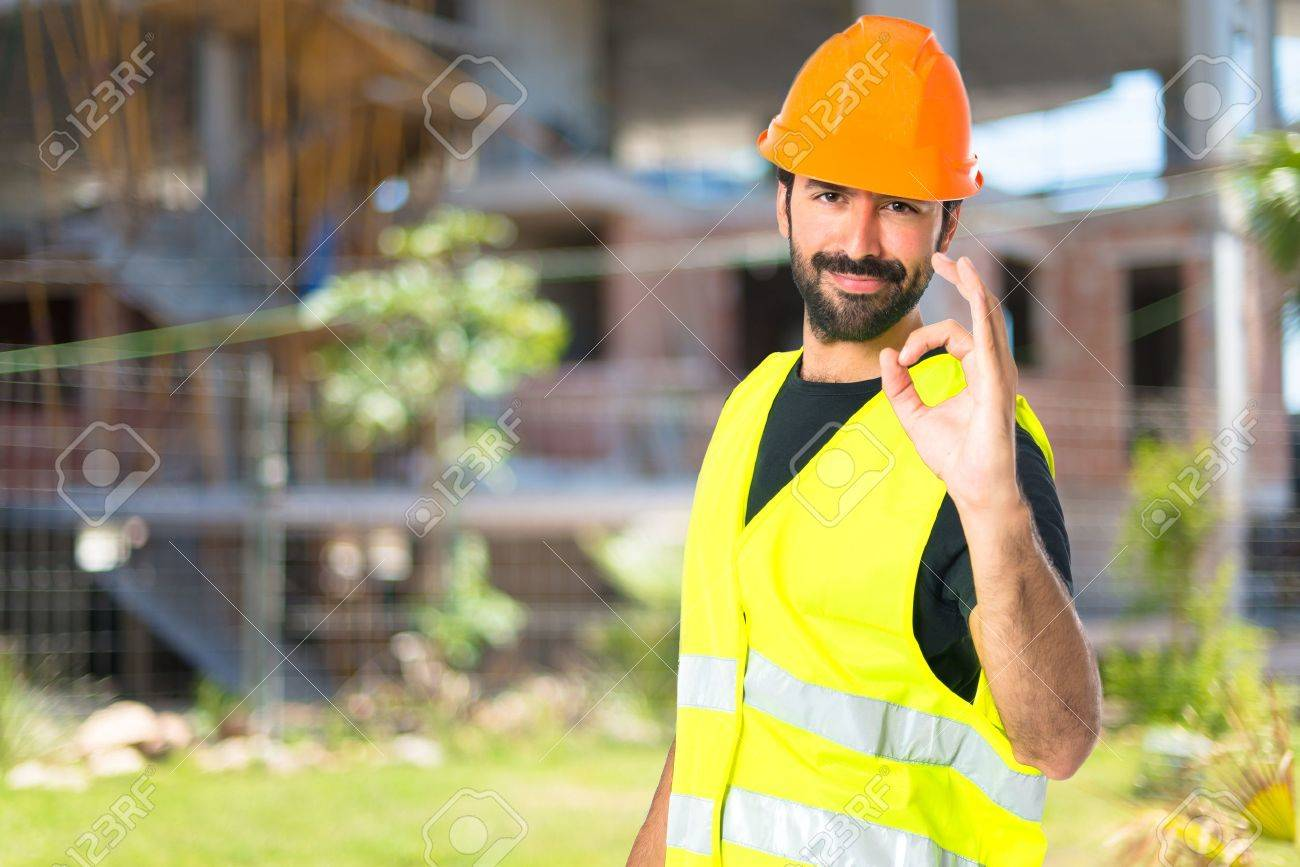 Workman making Ok sign over white background Stock Photo - 48309415