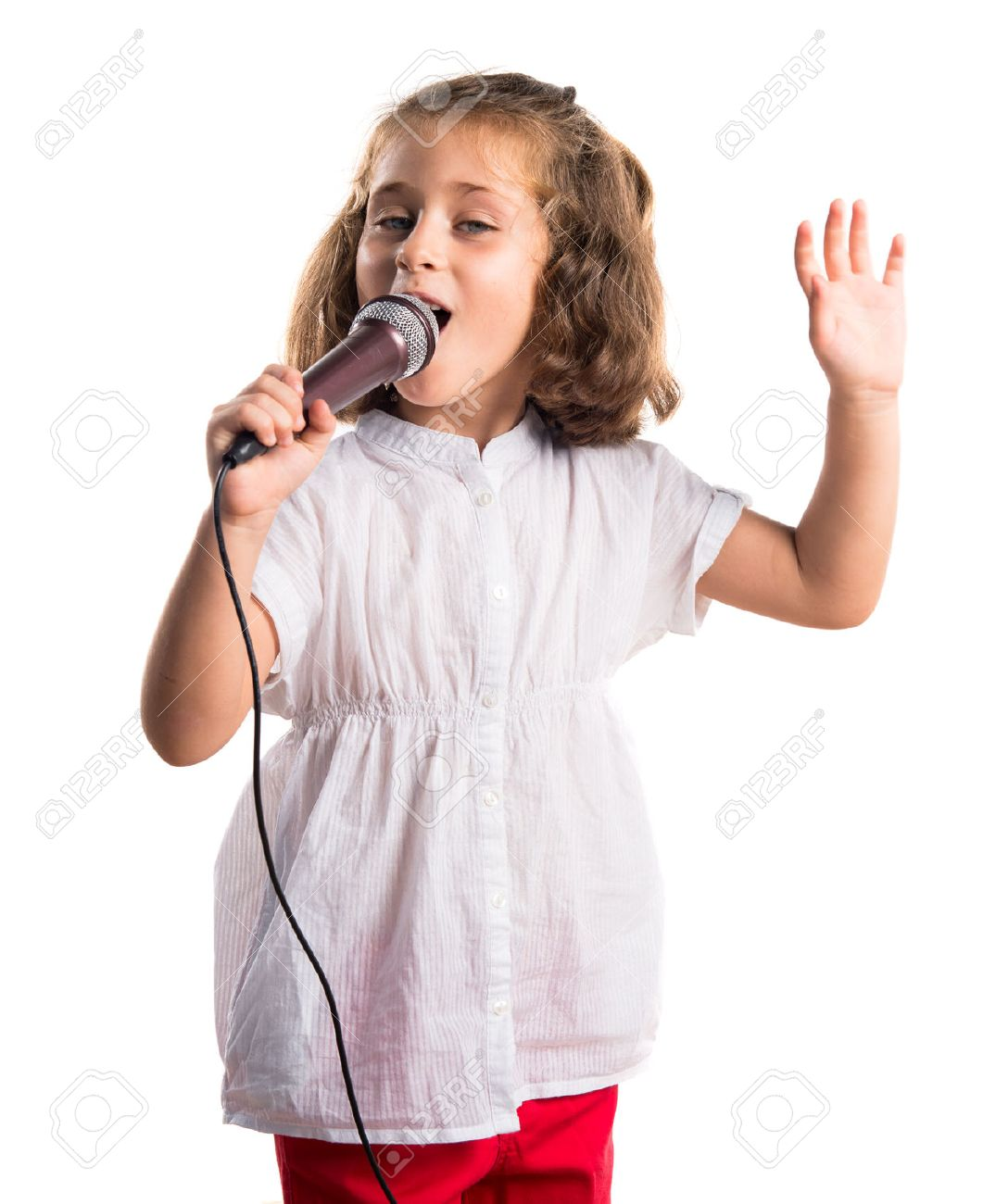 Girl singing with microphone Stock Photo - 48454411