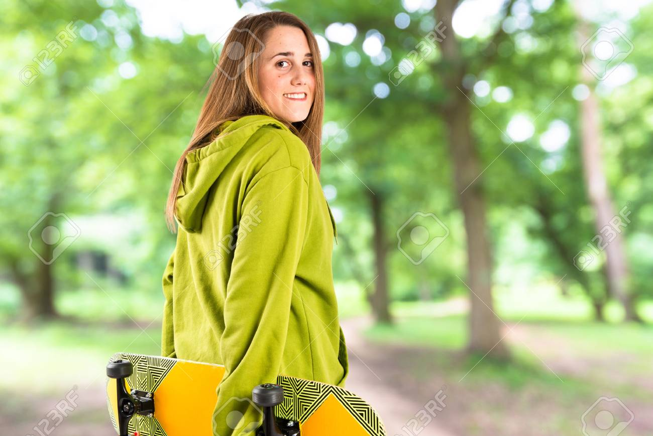 aed84325f8b Skater with green sweatshirt over white background Stock Photo - 65207394