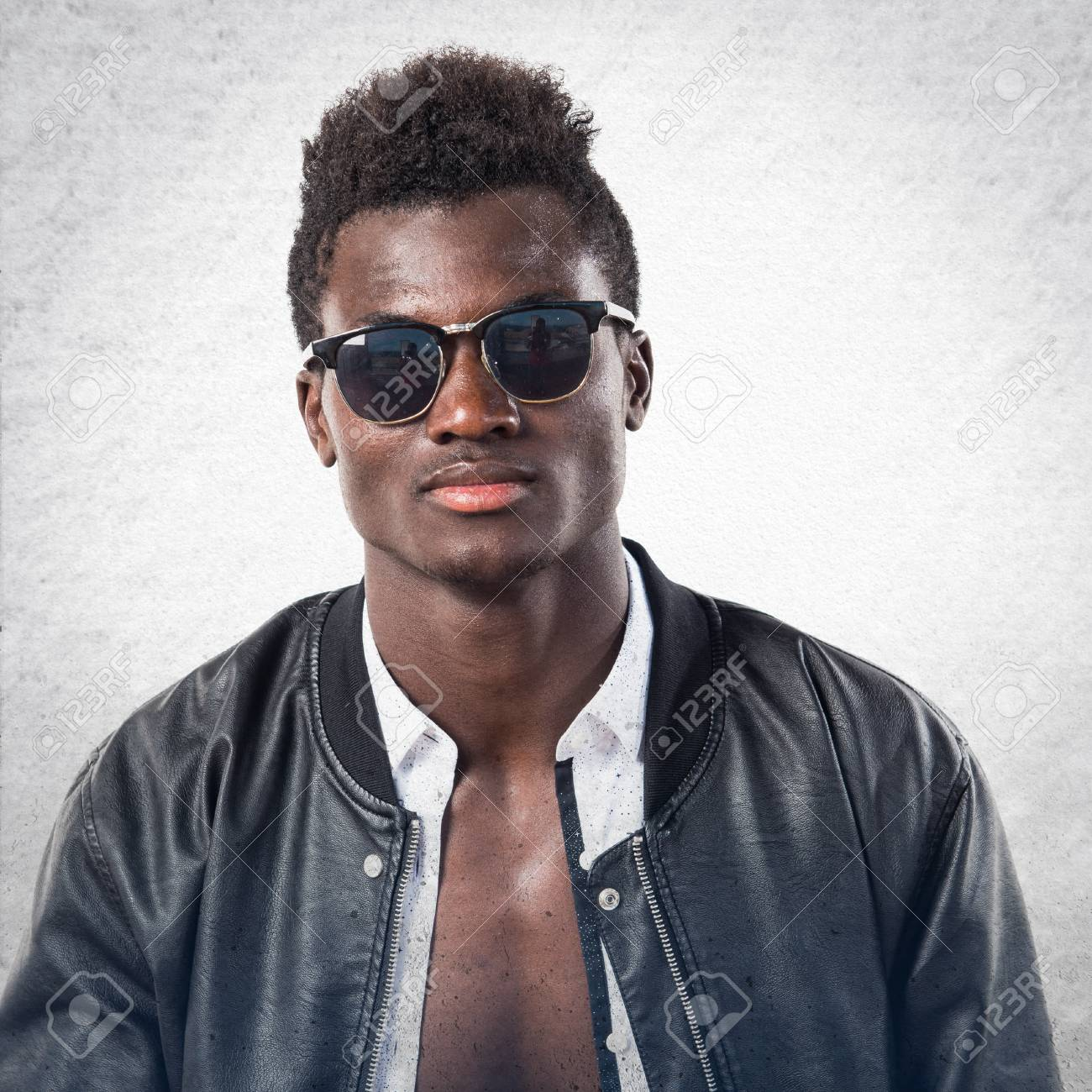 51f243220a Handsome black man with sunglasses posing in studio Stock Photo - 70916698