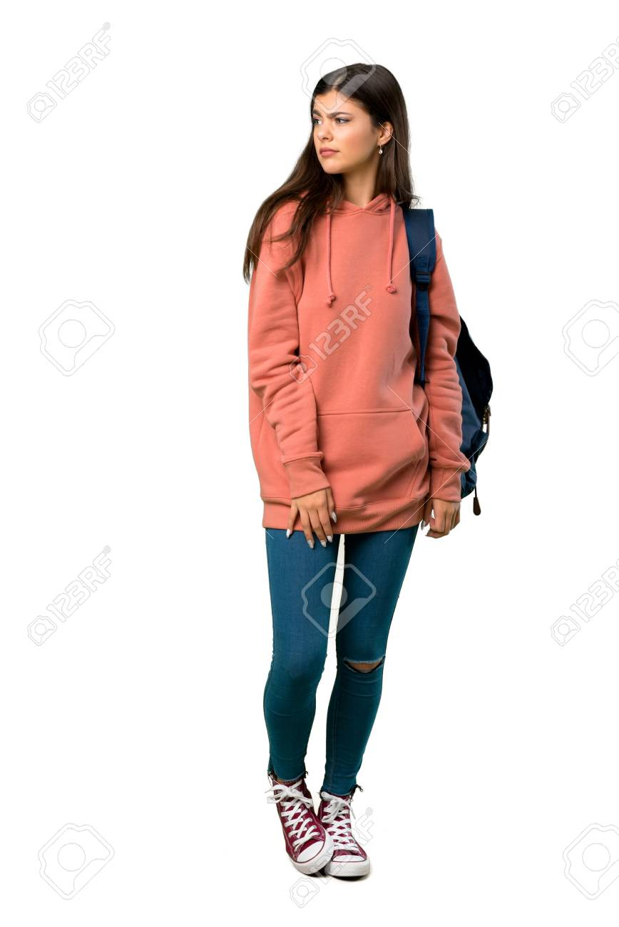 A full-length shot of a Teenager girl with sweatshirt and backpack feeling upset - 116494247