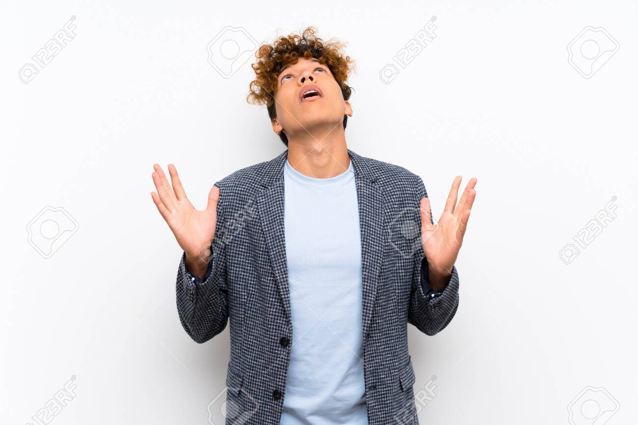 Fashion african american man over isolated white wall frustrated by a bad situation - 124671400