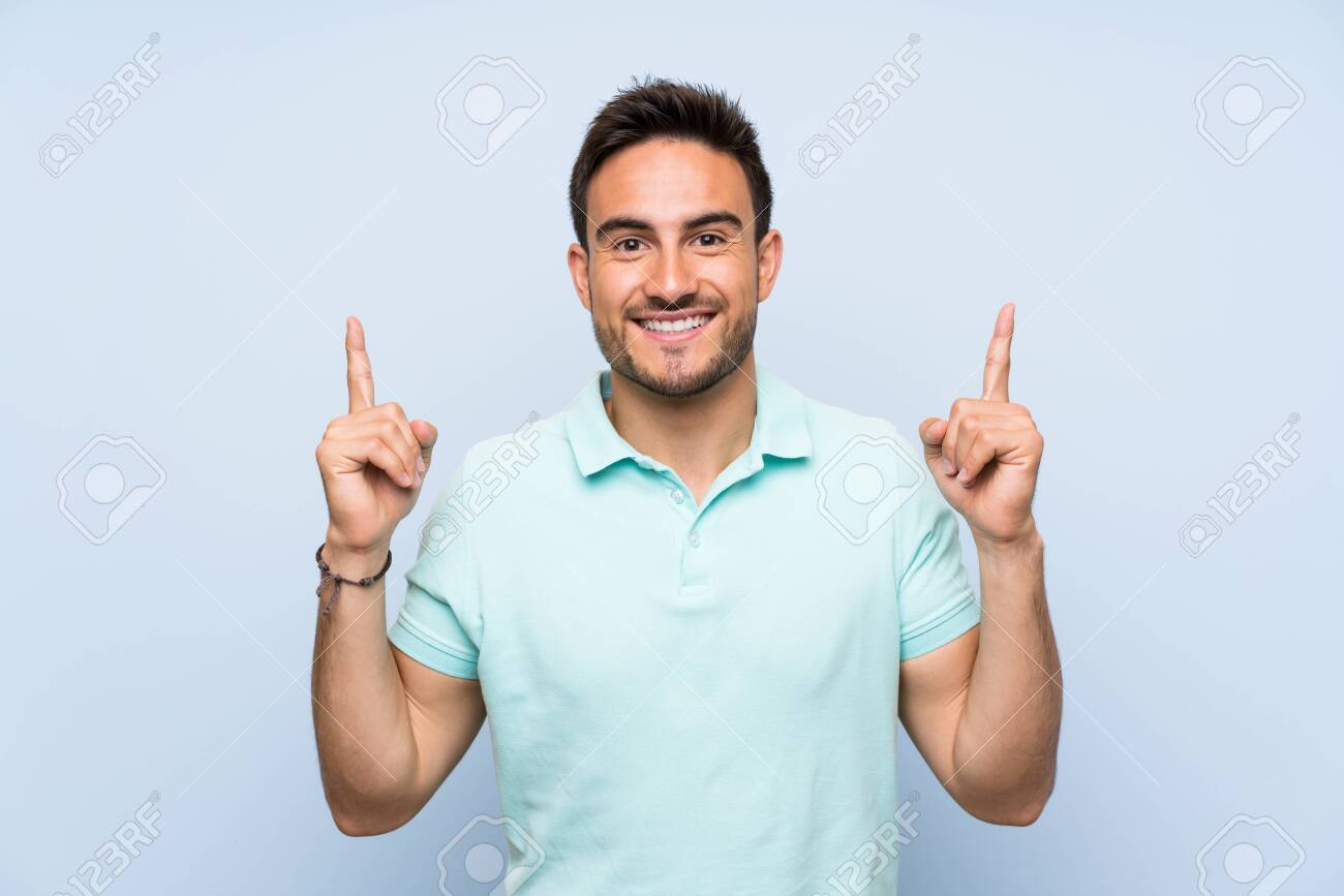 Handsome young man over isolated background pointing up a great idea - 131366707
