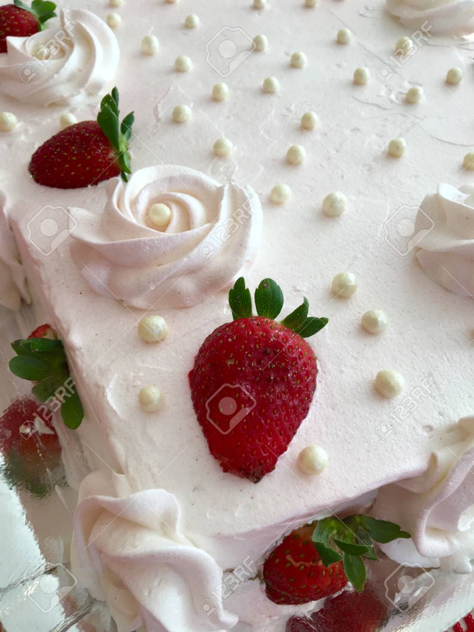 Detail Of A Cake With Decorated Topping And Fresh Strawberries