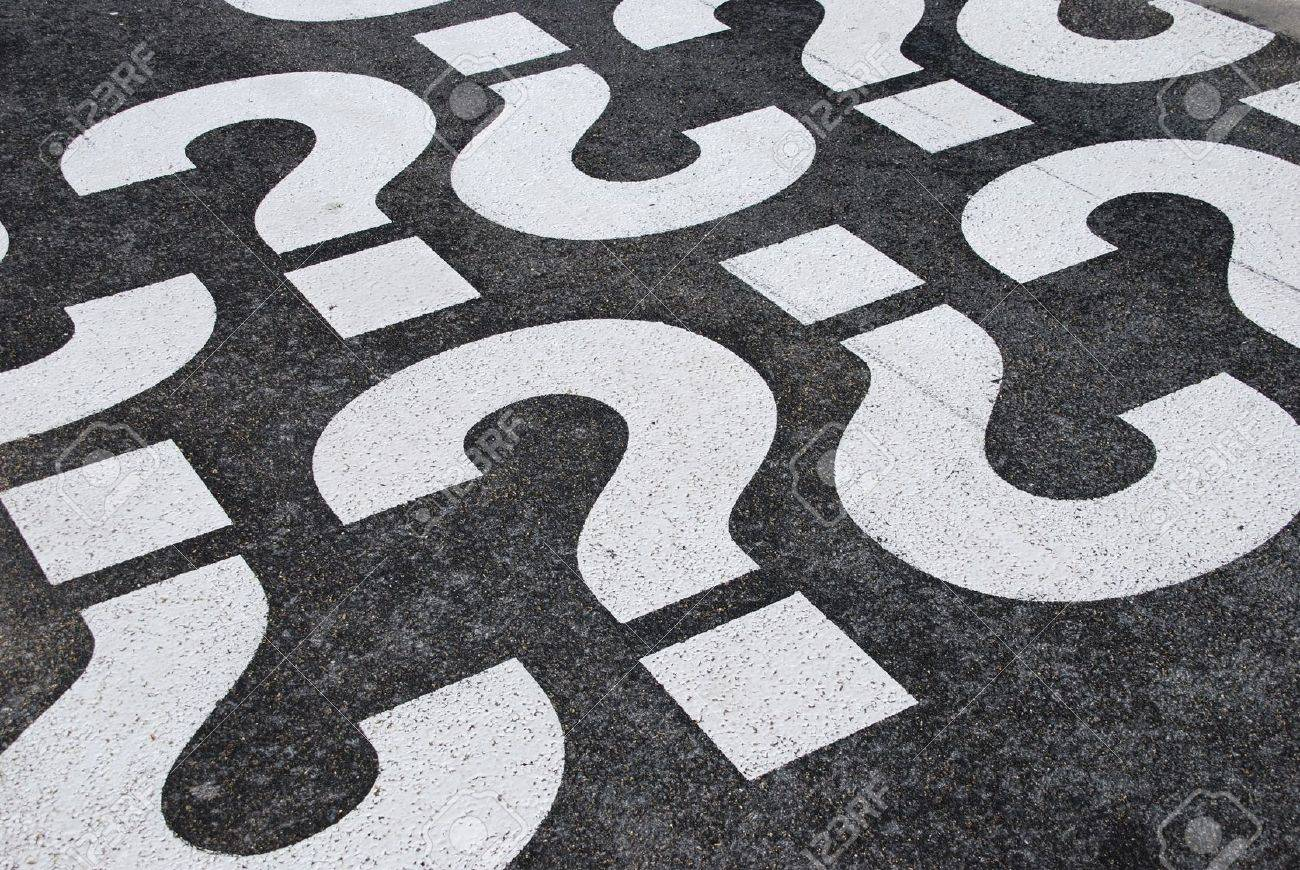 question mark signs painted on a asphalt road surface Stock Photo - 6795917