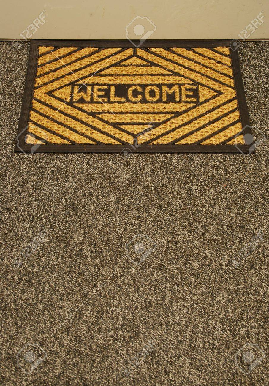 Beautiful Welcome Home Door Mat On A Grey Carpet Stock Photo   6914253