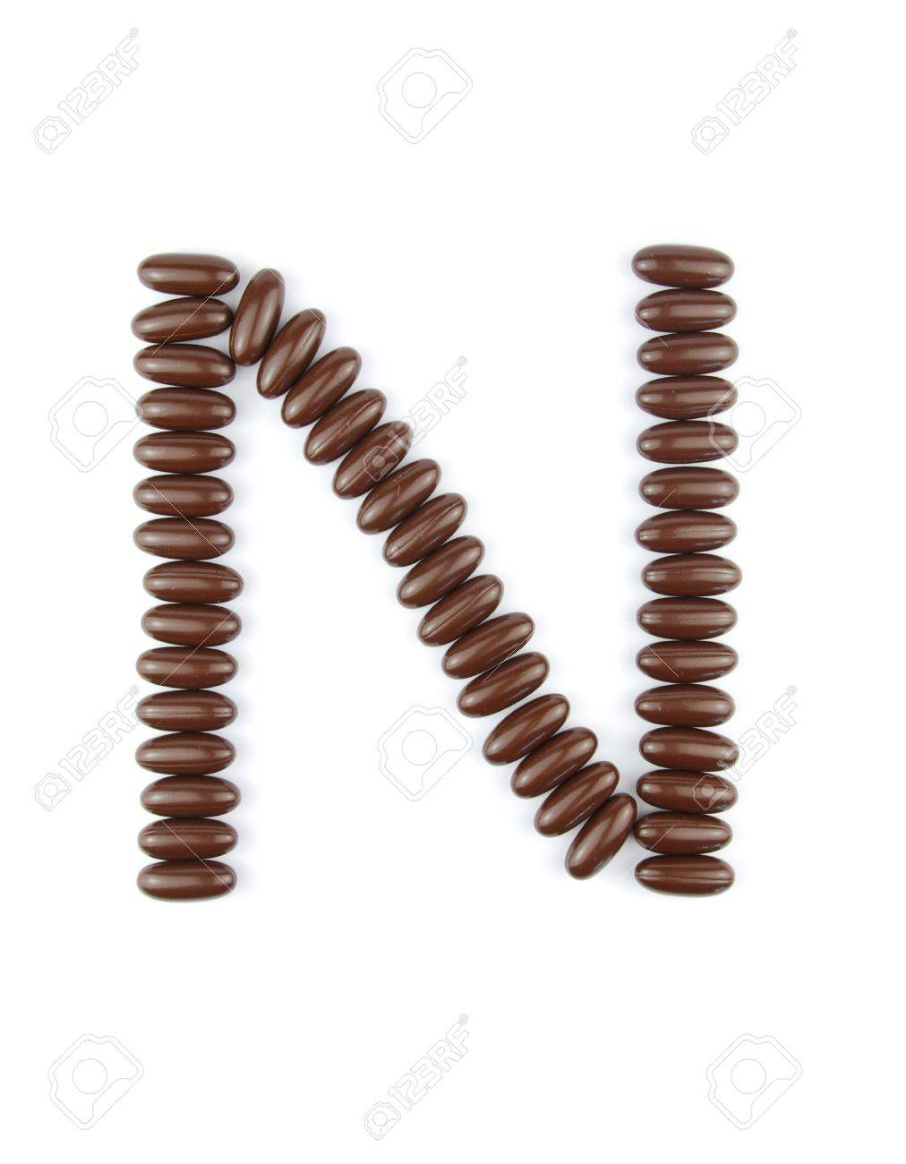 alphabet letter N with chocolate candies (isolated on white background) Stock Photo - 7195588