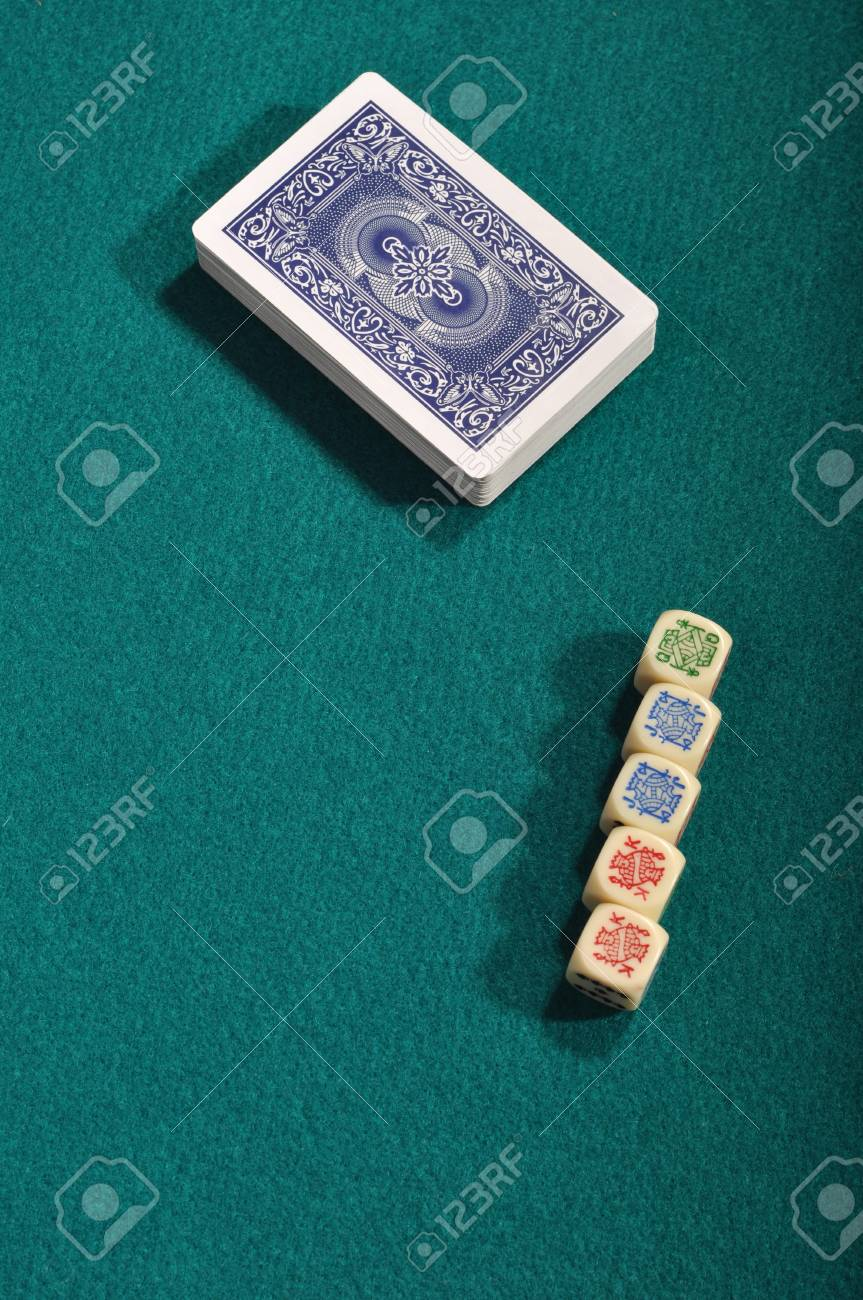 poker cards and dices on a green cloth background Stock Photo - 7561545