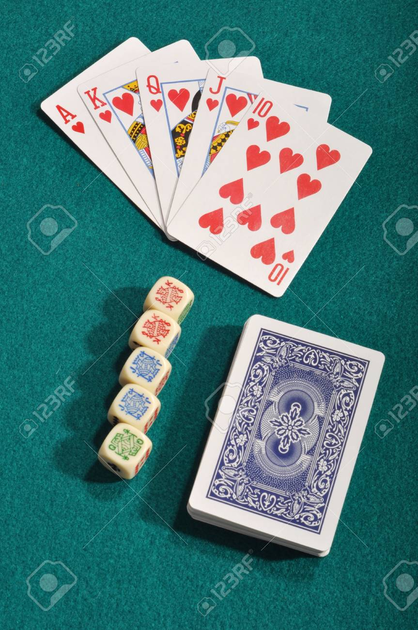 royal flush, poker cards deck and dices on a green cloth background Stock Photo - 7561542