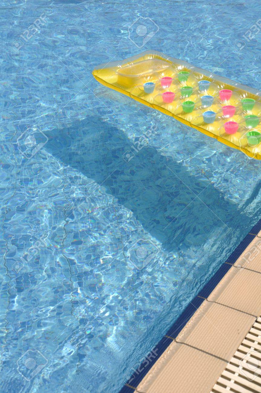 gorgeous swimming pool side with colorful water mattress Stock Photo - 7783459