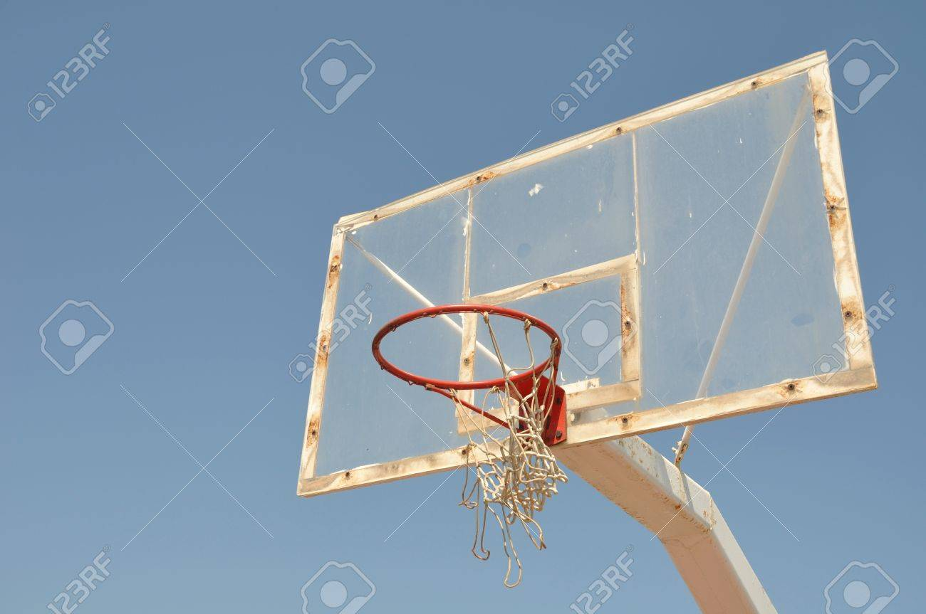 Old Outdoor Basketball Hoop Against Blue Sky Background Stock ...