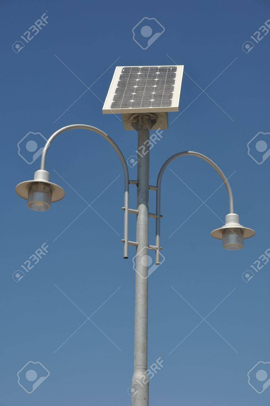 street lamp post with solar panel energy (against blue sky background) Stock Photo - 7917090