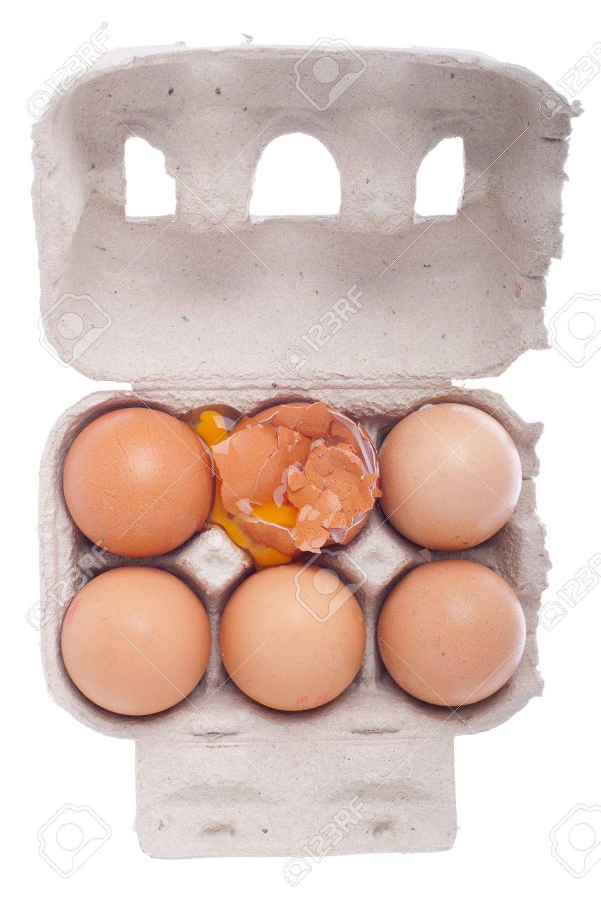 broken egg in a carton box isolated on white background Stock Photo - 8671517