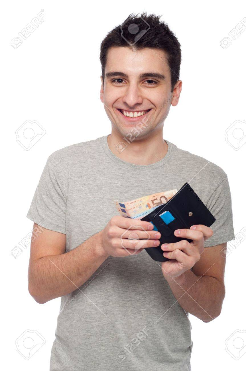 smiling young man showing his wallet with money and cards (isolated on white background) Stock Photo - 8818365