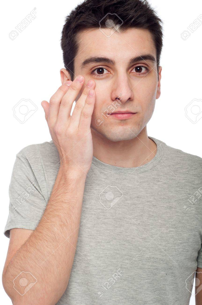 Handsome Young Man Applying Eye Cream For Dark Circles Isolated
