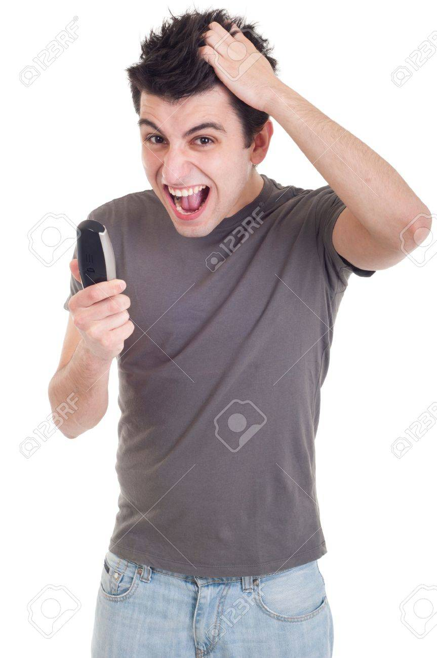 angry young man yelling at mobile phone isolated on white background Stock Photo - 9304652