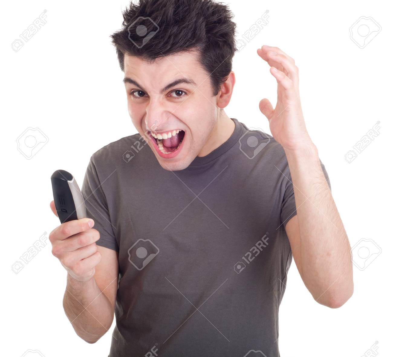 angry young man yelling at mobile phone isolated on white background Stock Photo - 9304629