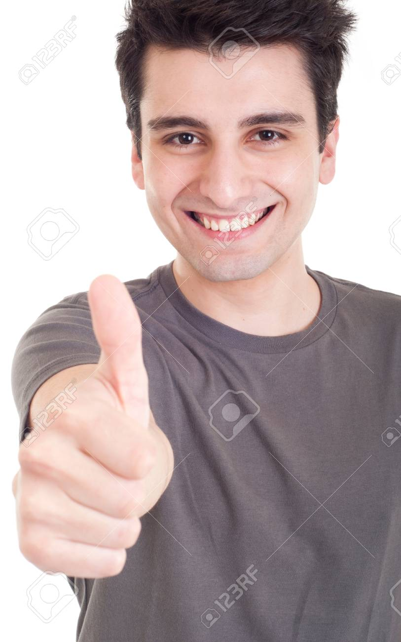 smiling young man with thumbs up on an isolated white background Stock Photo - 9304663
