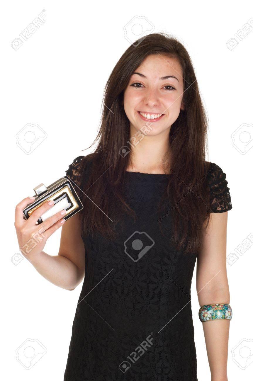 a96a40eef6 Bella donna di 18 anni i giovani in abito nero e borsa pronto per la serata  (isolato su sfondo bianco)