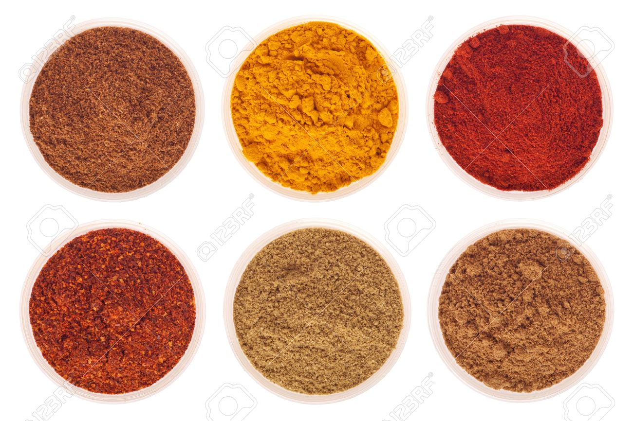 collection of indian spices (cumin, coriander, paprika, garam masala, curcuma, red pepper flakes) on glass cups isolated on white background Stock Photo - 9728956