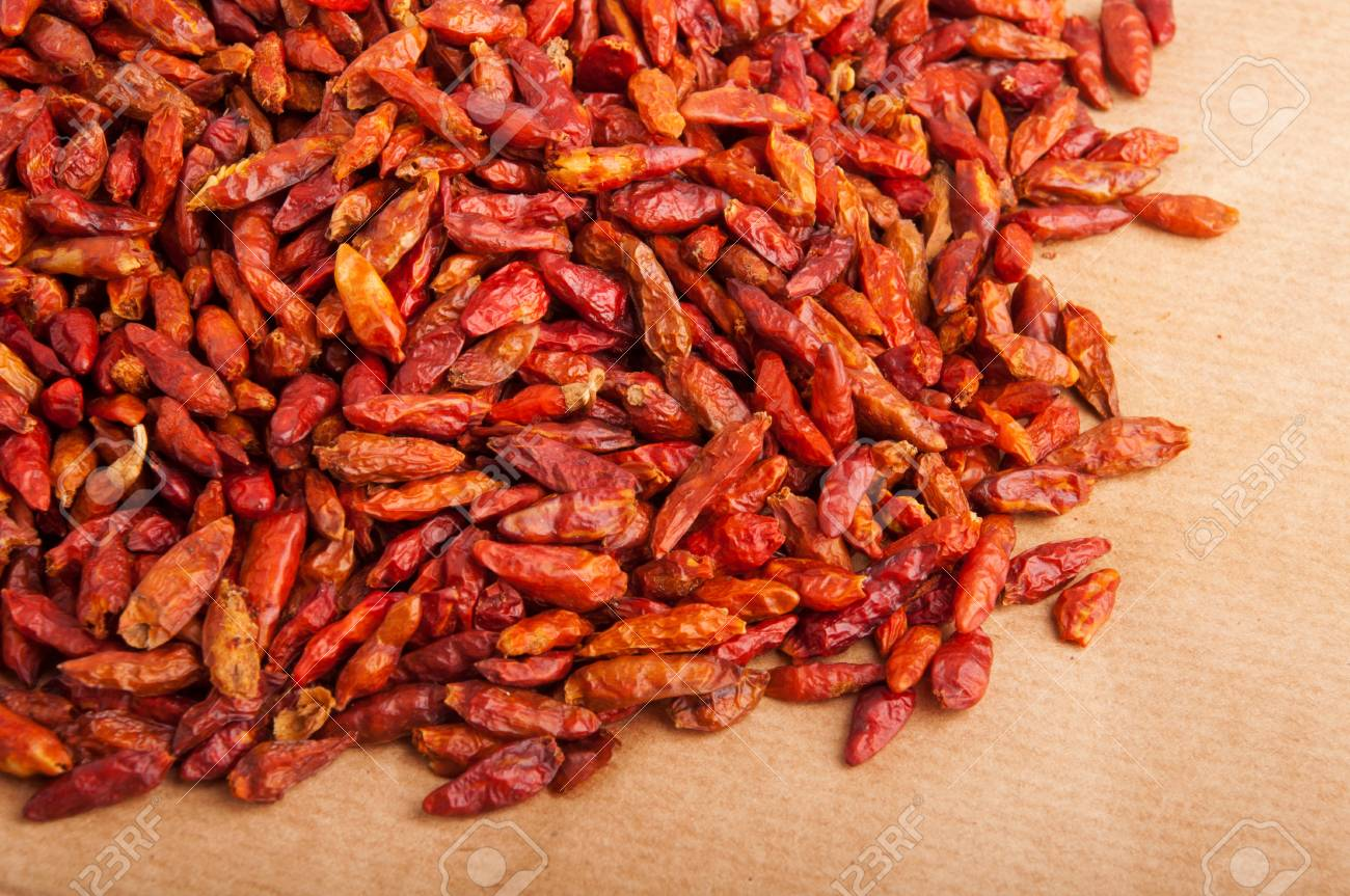 bunch of Piri Piri peppers on a brown background (close-up picture) Stock Photo - 9966693