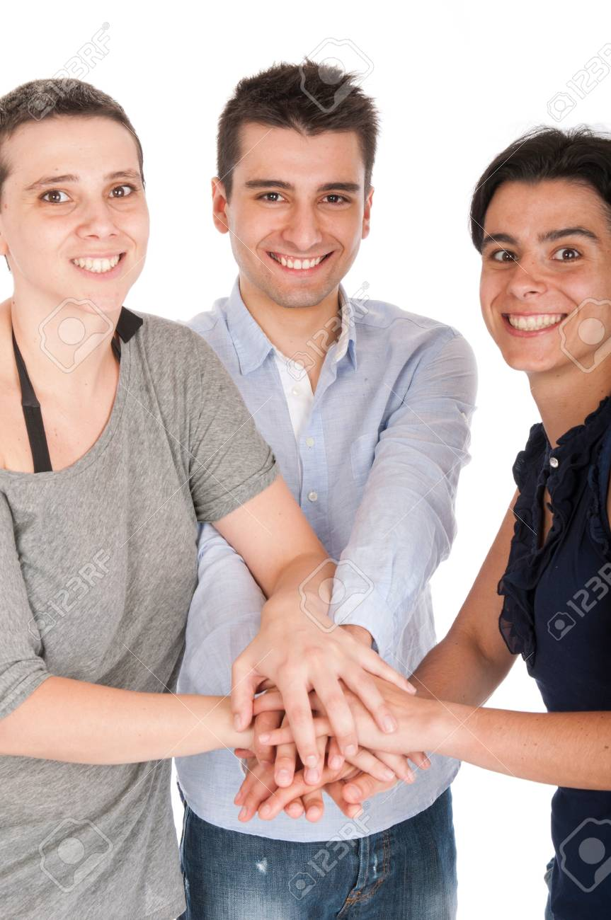 happy smiling brother and sisters putting their hands on top of each other celebrating their union or recent success (isolated on white background) focus on man Stock Photo - 10055427