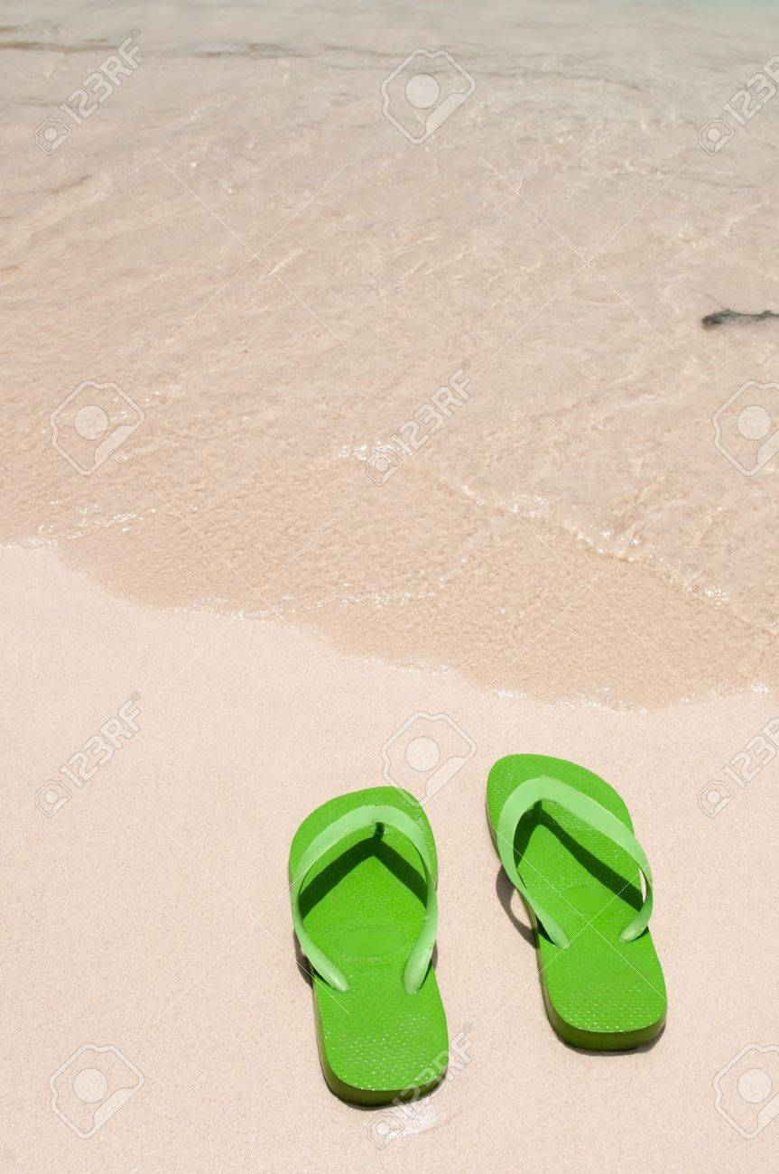 green flip flops on the beach (copy-space available) Stock Photo - 13144516
