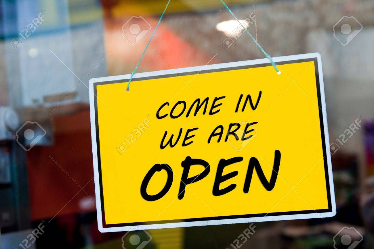 come in we are open sign hanging on a window door outside a restaurant, store, office or other - 13816941