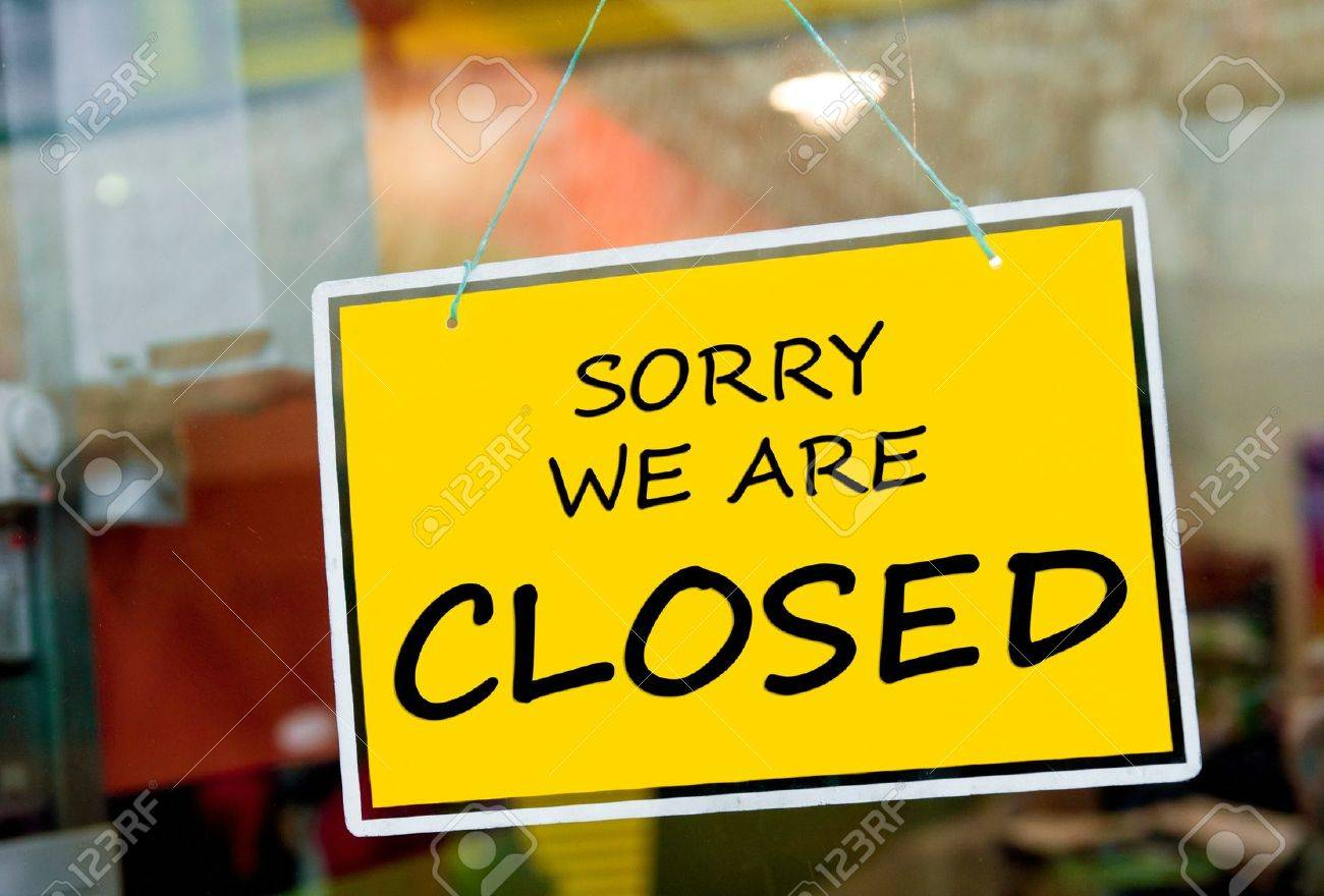 sorry we are closed sign hanging on a window door outside a restaurant, store, office or other - 14988411