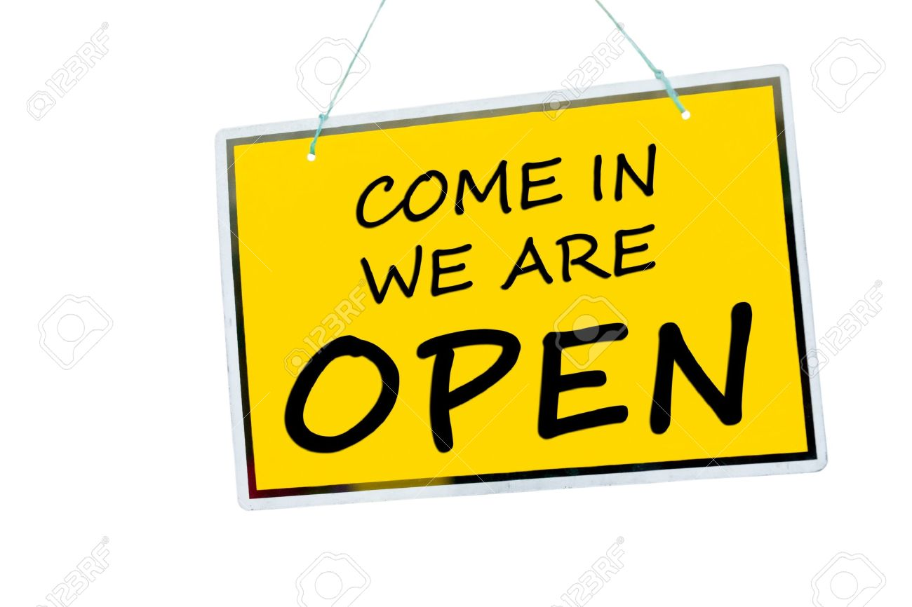 come in we are open sign hanging isolated on a white background Stock Photo - 15701458